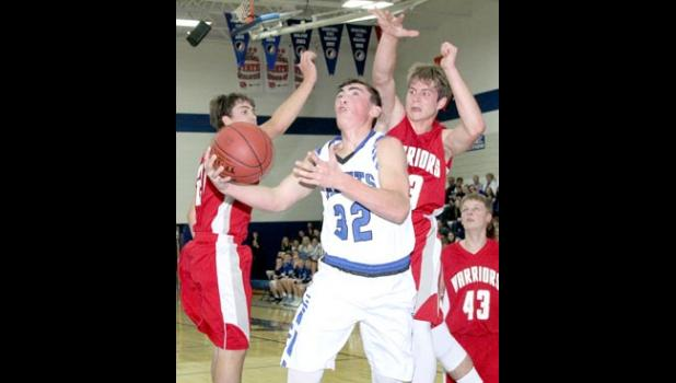 Clayton Ollendieck goes up for a shot attempt against the Warriors.